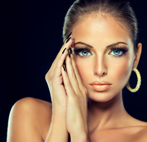 model with the Golden makeup and metal nails.